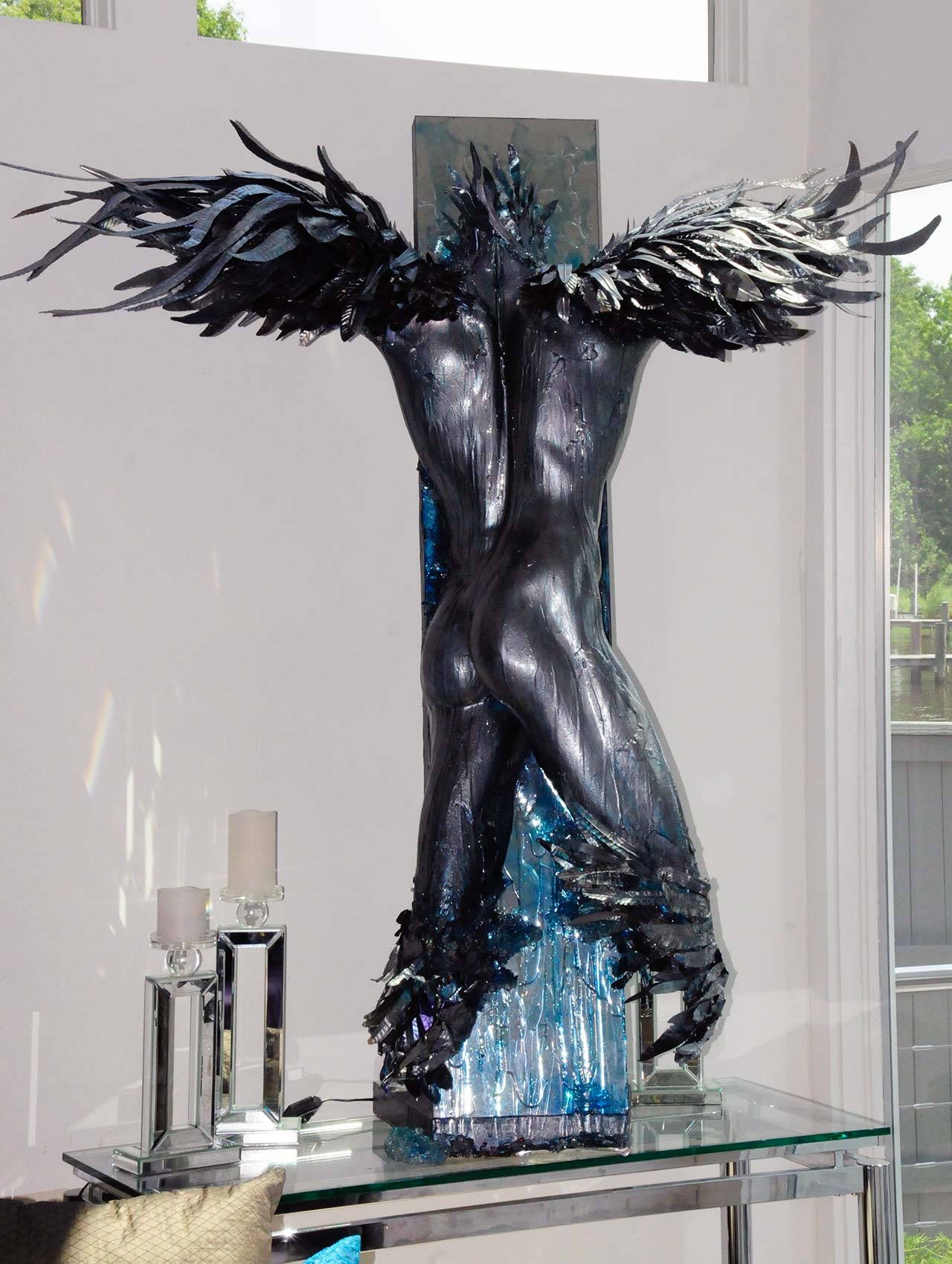 Winged Icarus metal and resin sculpture