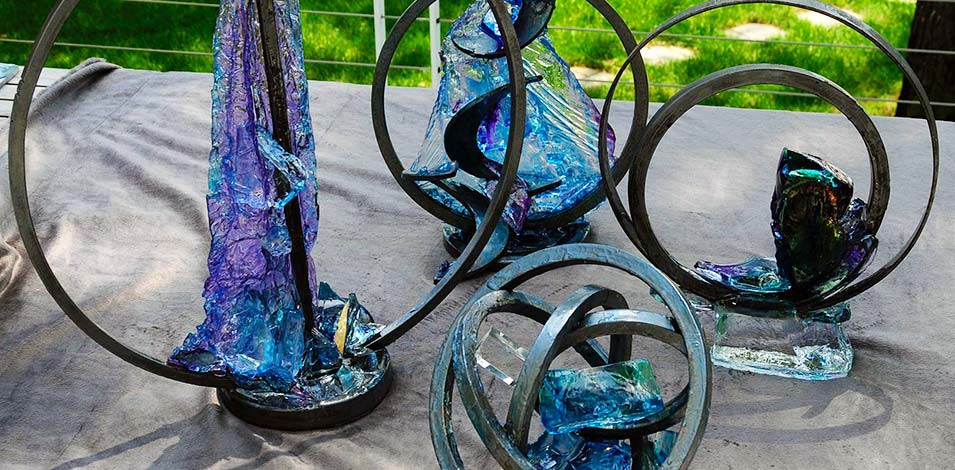 Metal and dyed resin sculptures